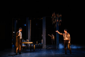 Giovannin raises his hand and points at Leporello