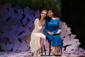 Sisters Olga and Tatyana sit together