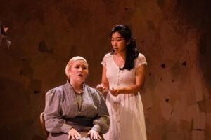 The nurse Fillipnyeva sits and sings to Tatyana