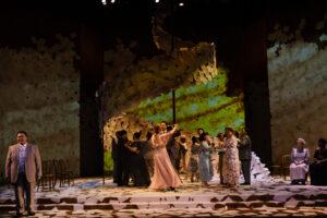 Olga dances with Onegin while a jealous Lenski looks on