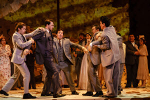 Party attendees separate a fighting Lenski and Onegin