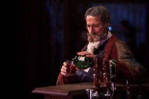 Falstaff pours himself a drink