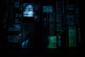 Video projections show the faces of the Governess and the ghosts