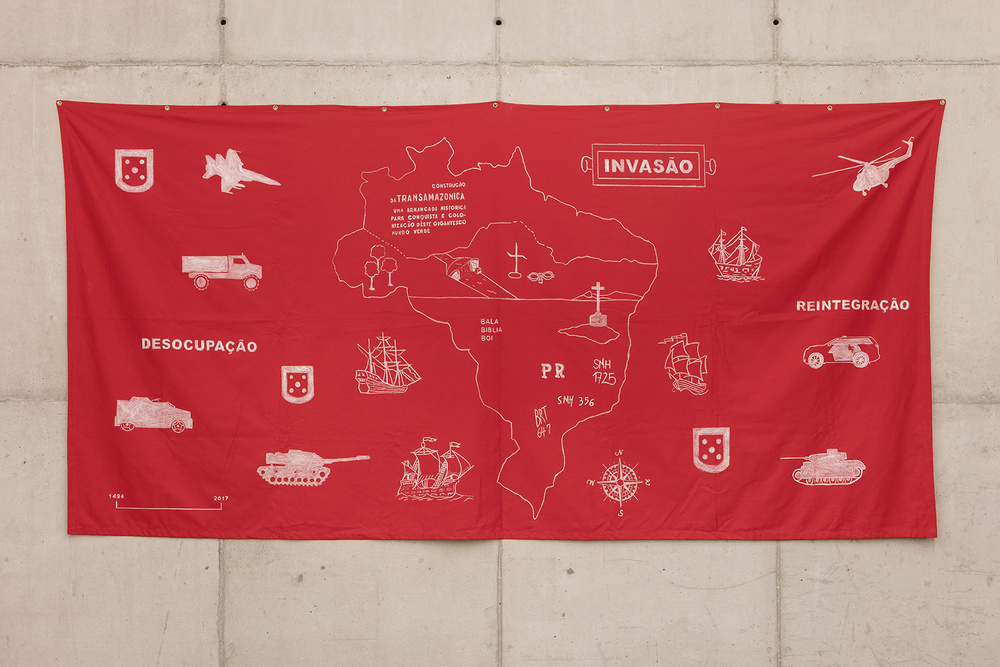 red cotton banner with various visual references to military equipment