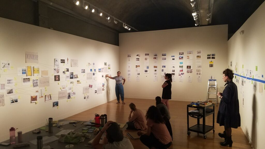 Co-curators at wall display