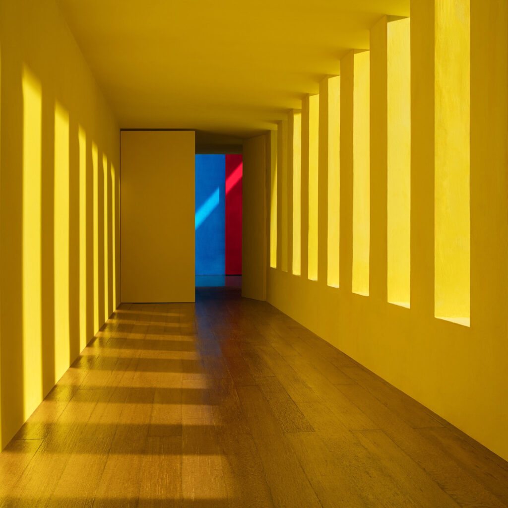 Residential house designed by Luis Barragan, hallway with yellow light