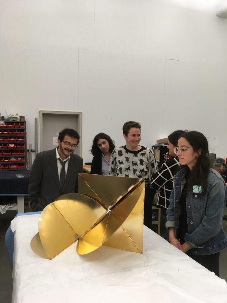 Students examine one of artist Lygia Clark's Bicho's in the Museum of Fine Arts, Houston vault