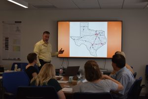 Ray Miller, Jr., AICP, giving an overview of transportation in the Texas Triangle