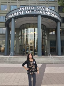 Nicole in front of the US Department of Transportation office