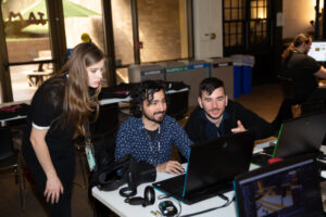 Students working together on a laptop during the VR Austin Jam