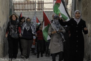 Palestinian women participating in a protest march. Photo Credit: Tal King Creative Commons Flickr.