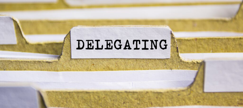 """The word '""""delegating"""" on a yellow file tab"""