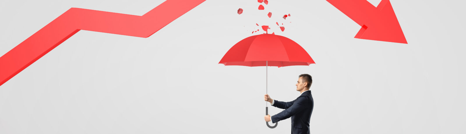 Businessman protecting himself from a broken statistical trendline with an umbrella.
