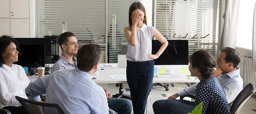 Embarrassed female employee at a meeting.