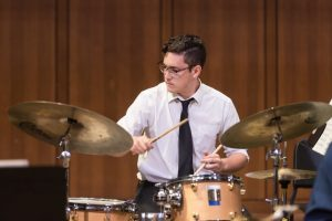 Greg Clifford takes a drum solo with the UT Jazz Orchestra in Bates Recital Hall.