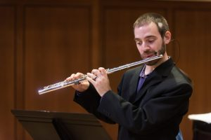 Flutist Bryan Kennard plays one of his compositions with the UT Jazz Orchestra.