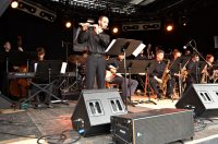 UTJO on stage at Montreux with flutist Bryan Kennard playing