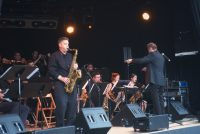 saxophonist Dave Sayers improvising in front of UTJO