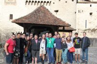group picture of UTJO in front of castle in Europe