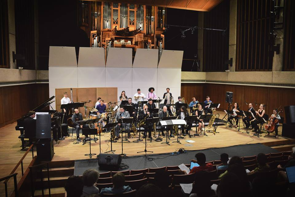 on stage group photo of UT jazz orchestra
