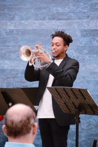 trumpeter Ari Burns playing at Blanton museum