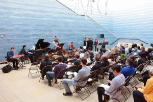 full audience watches on as AIME performs at Blanton museum atrium