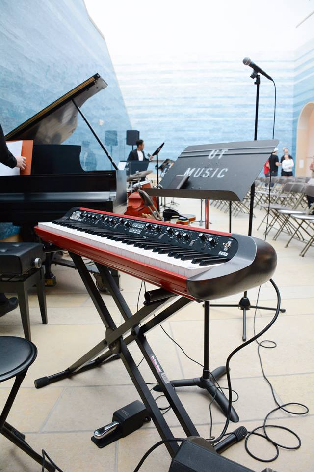 keyboard set up in atrium of Blanton museum before AIME concert