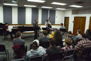 Ernie Watts plays with masterclass students