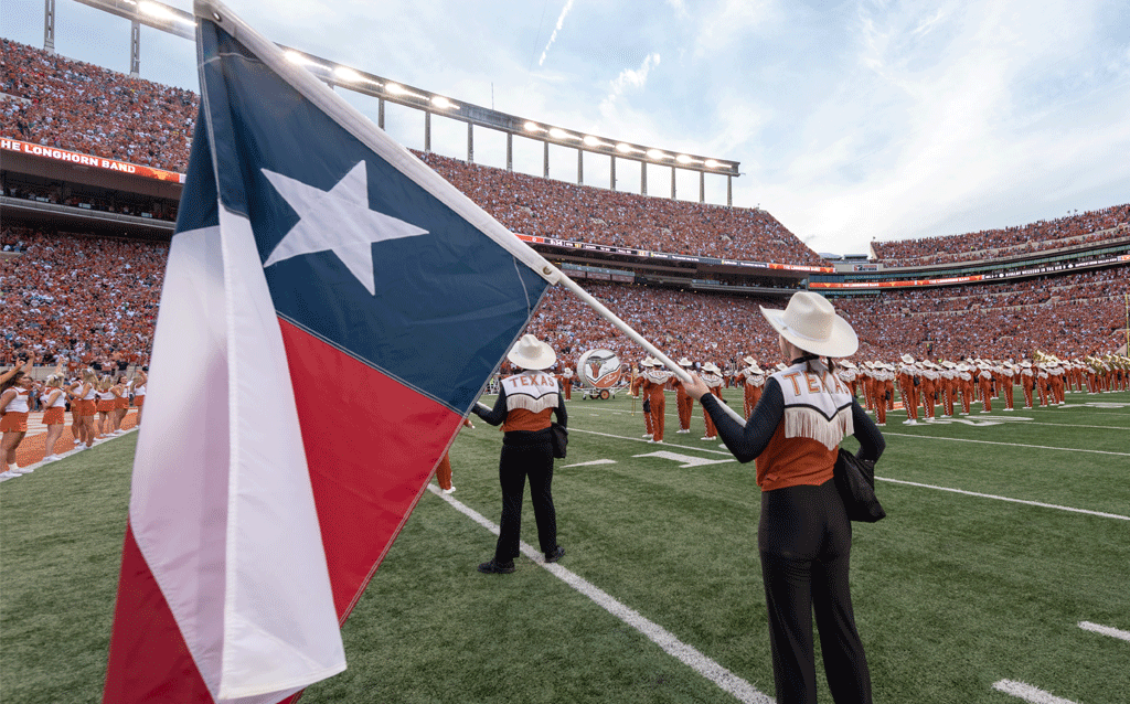 Texas Flag held by color guard member on field