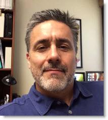 headshot of Raul Longoria