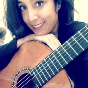 Golriz Shayani poses with guitar