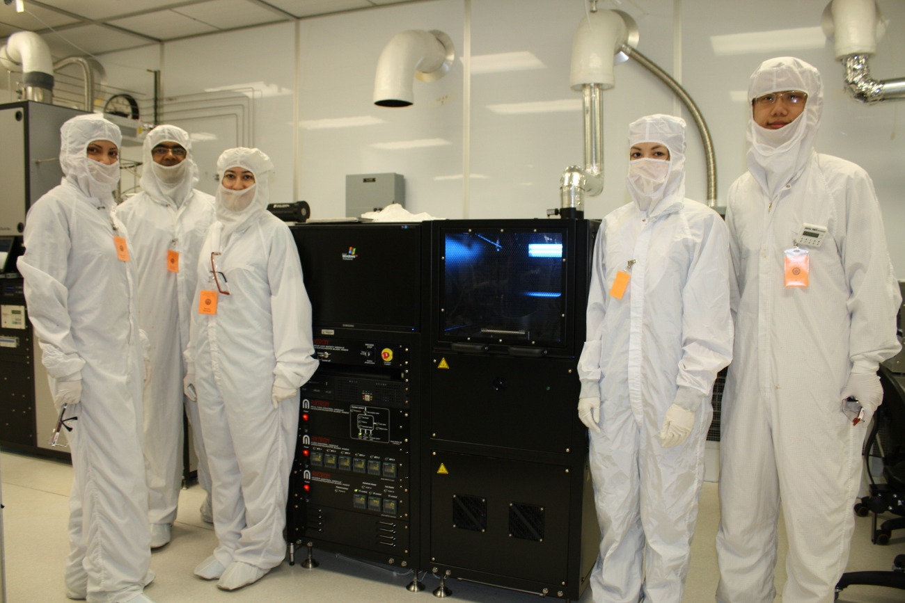 Group members in front of the Black Magic CVD oven