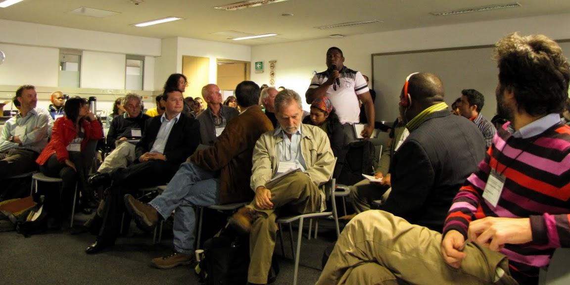 """Discussion at the Forum, """"Cartografia participative y derechos al territorio y los recursos,"""" held June 1-2, 2011 at the Universidad de los Andes, Bogota, Colombia. Photo courtesy Marcela Wagner."""