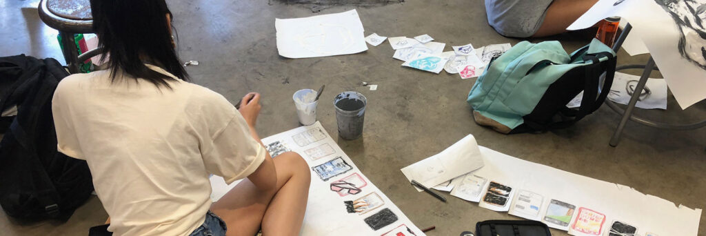 Grace G. works on a concentration project.