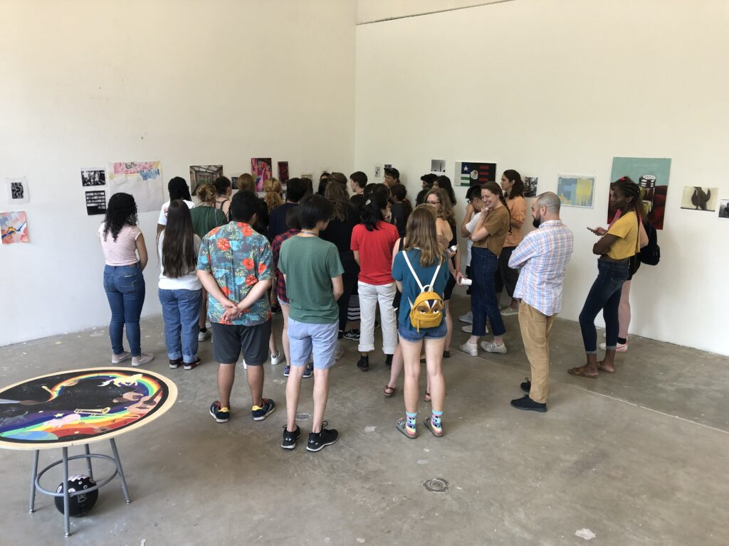Students offer peer reviews at Friday Critique, Intensive 2019