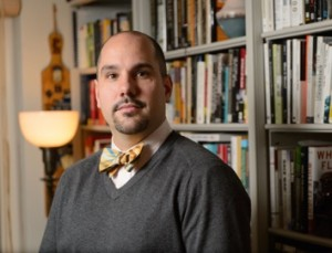 Matthew Hughey, associate professor of sociology at this office at the University of Connecticut on Nov. 12, 2013. (Peter Morenus/UConn Photo)
