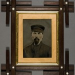 Man in Work Hat. Unidentified photographer. Ca. 1880. Oil on tintype. Rural Gothic Revival style frame.