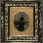African American Woman with Painted Sea Shore. Unidentified photographer. Oil on tintype. Ca. 1875. Marbleized green Eastlake style frame.