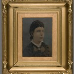 Woman with White Ruffled Collar. B. Phillips. Oil on tintype. Ca. 1868. Rococo Revival style gilt frame.