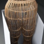 This wicker dress form from the film costumes collection is spray painted gold. The legs of the dress form are stored upright. Photo by Anthony Maddaloni.