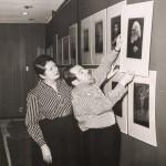 Unidentified Photographer. Helmut and Alison Gernsheim hanging an exhibition at Wayne State University, Detroit, Michigan. 1963. Gelatin silver print.