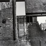 "Clarence John Laughlin, ""Three Vistas through One Wall,"" 1937. Gelatin silver print. 26.4 x 36.8 cm. © The Historic New Orleans Collection."