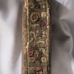 Spine of the Bible. The three-dimensional raised embroidery work on the spine was a popular needlework style in the seventeenth century.