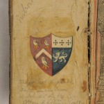 Inside front cover of the Bible, showing the arms of the Derbyshire Sleigh family on the left half of the shield.