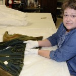 Nicole Villarreal, Human Ecology graduate student at The University of Texas at Austin, is studying the stitching and construction history of the 'Gone With The Wind' costumes as the Center begins the initial stages of conserving the dresses. Photo by Anthony Maddaloni.