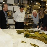 Ransom Center curators Steve Wilson (second from left) and Jill Morena (second from right) discuss construction history of the green curtain dress from 'Gone With The Wind.' University colleagues from Human Ecology include from left, Dr. Kay Jay, Director of the Historical Textiles and Apparel Collection; Dr. Bugao Xu, Professor in the Division of Textiles and Apparel; Dr. Sheldon Ekland-Olson, Director of the school; and Nicole Villarreal, Human Ecology graduate student. Photo by Anthony Maddaloni.