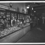 "Unidentified Itinerant Photographer, ""E. J. Hitt Cigar Co. Store No. 2,"" 1934. Gelatin silver glass plate negative."