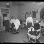 "Unidentified Itinerant Photographer, ""Unidentified Barber Shop,"" 1934. Gelatin silver glass plate negative."