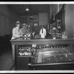"Unidentified Itinerant Photographer, ""Unidentified bar,"" 1934.Gelatin silver glass plate negative."