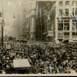 Photo of Houdini suspended above crowd in front of Pittsburgh Post building, dated November 6, 1916.